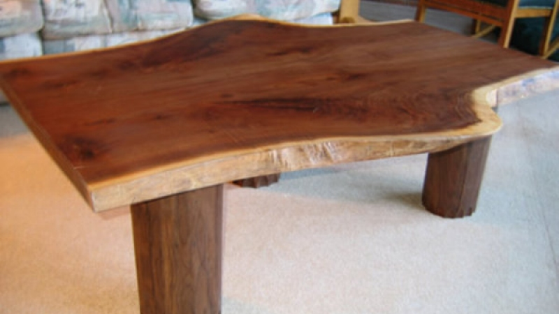 Walnut burle table - 3' x 5' on walnut log legs