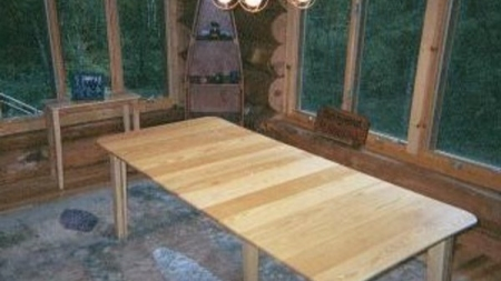 Ash table in a log cabin on a river